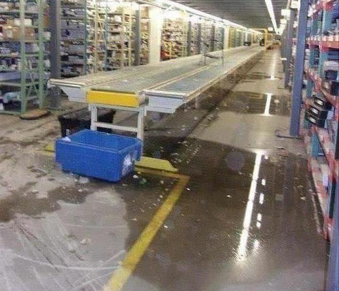 Pool of water in warehouse.