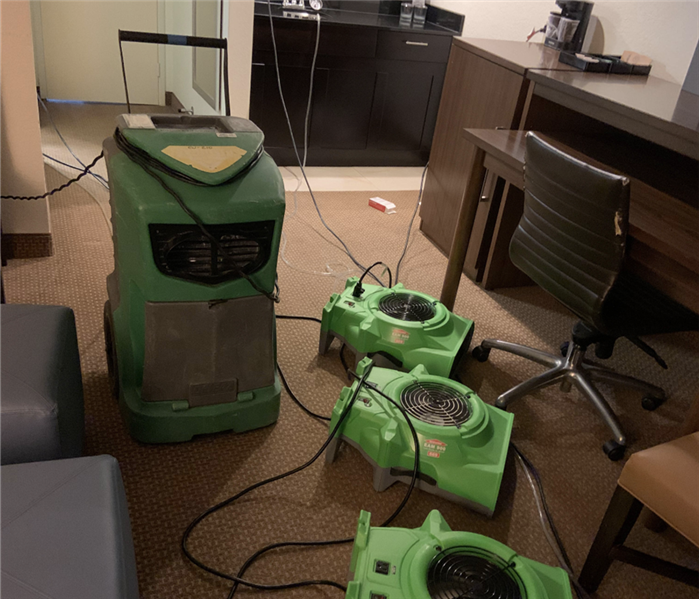 Dehumidifier and air movers in action.