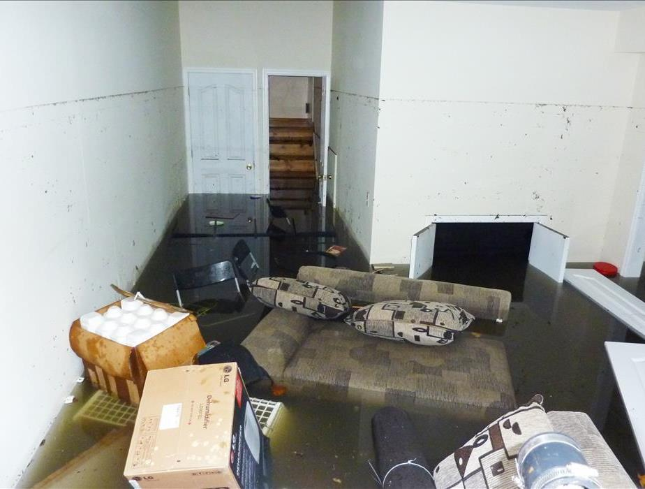 Completely flooded basement. There is a visible line showing maximum water level higher than 7 feet.