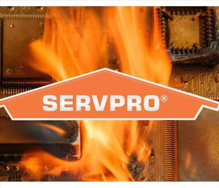 Background of an electronic on fire with SERVPRO logo on front of the picture